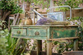 Best garden trends: image of garden furniture with watering can