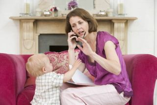 mother with baby and cell phone