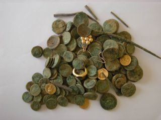 A treasure trove of gold and silver coins along with gold jewelry was uncovered in Israel and dates back to the Roman Empire.