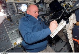 NASA astronaut Scott Kelly floats in space.