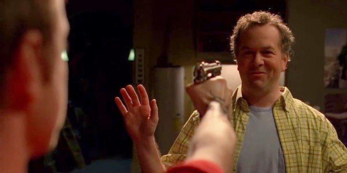 Jesse aiming his gun at Gale in Breaking Bad.