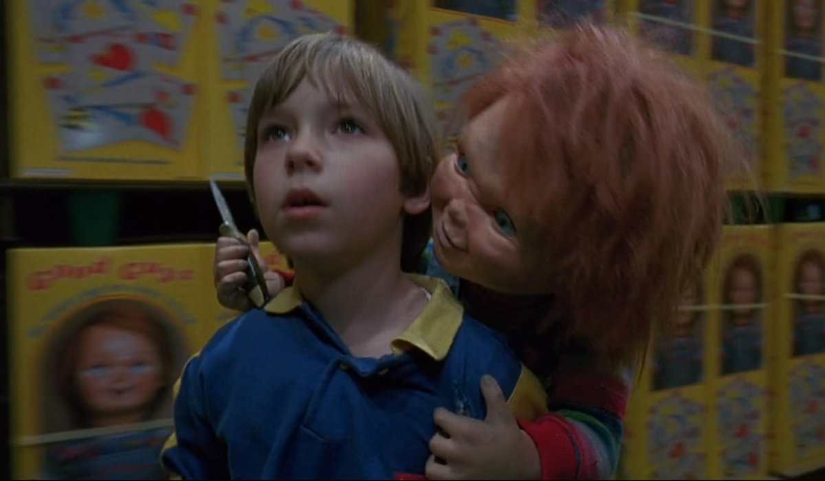 Child's Play 2 Chucky threatening Andy in the Good Guys' warehouse