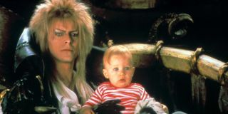 Labyrinth Jareth holds Toby in a chair