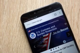 An iPhone displaying the website of U.S. Customs and Border Protection.