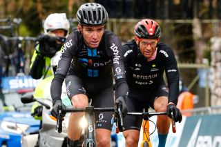 Romain Bardet (DSM) rides ahead of Damiano Caruso (Bahrain Victorious) on the Passo Giau
