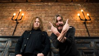 Opeth's Fredrik and Mikael throw devil horns in a London pub