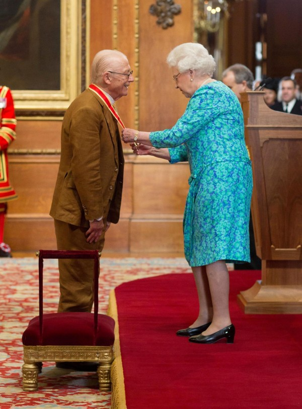 John Hurt is knighted by the Queen