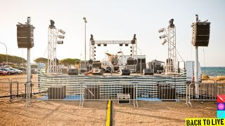 A full stage set up for an outside concert
