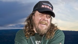 Red Fang's Bryan Giles wearing a trucker cap and smiling