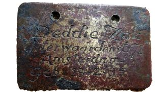 An identity tag belonging to 8-year-old David Jacob (Deddie) Zak, found at Sobibor death camp where he was murdered.