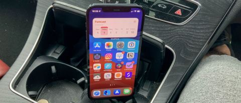 Syncwire Universal Car Phone Holder in a car holding an iPhone