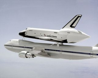 The prototype space shuttle Enterprise aboard its carrier aircraft in 1983.