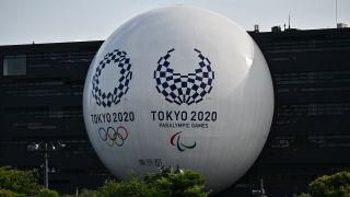 How to watch the Tokyo Paralympics - Image shows Tokyo 2020 logos on the Hinomaru driving school