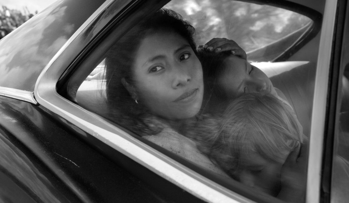 Roma Cleo riding in the backseat with the sleeping children