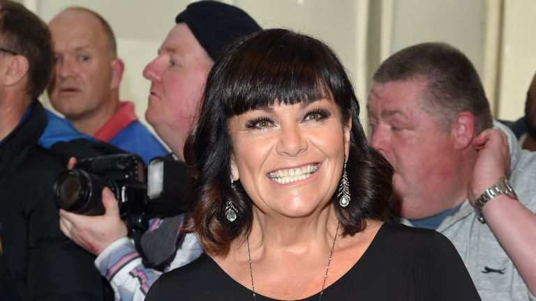 Dawn French has embraced short gray hair as she grows out her signature bob