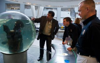 Dr. Neil deGrasse Tyson Displays Museum Exhibit to Astronauts Walheim and Hurley