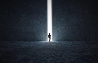 man walking towards light