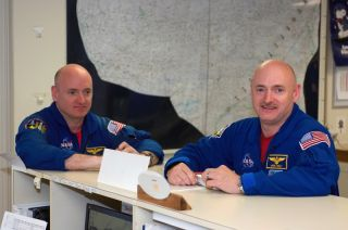 Mark and Scott Kelly in their flight suits