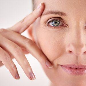 Woman touching her eye area