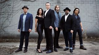 A press shot of Jason Isbell and his band