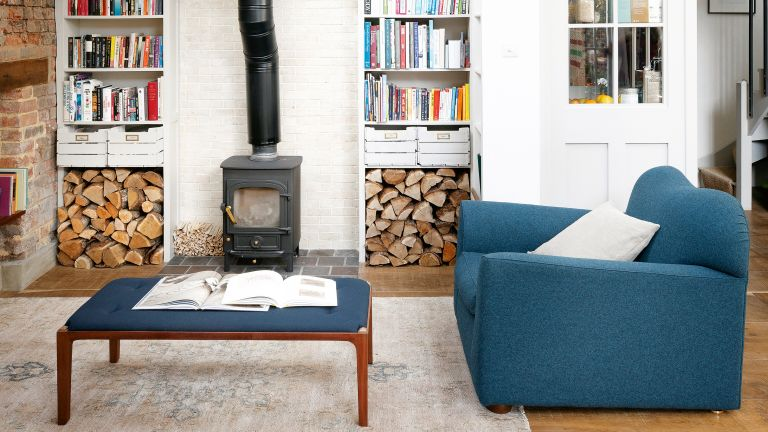 Living room with wood burner and built in shelving