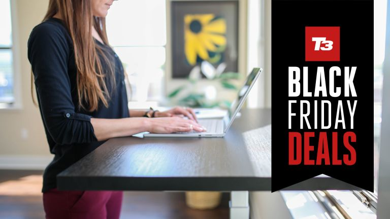 Person using standing desk, with Black Friday deals flag overlaid