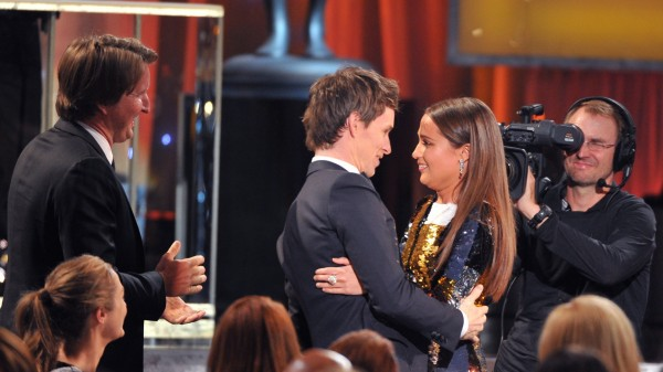 "Tom Hooper looks on from left, as Eddie Redmayne congratulates Alicia Vikander after she wins the award for outstanding female actor in a supporting role for ""The Danish Girl"" at the 22nd annual Screen Actors Guild Awards. (Vince Bucci/Invision/AP)"