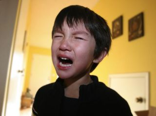 A little boy crying.