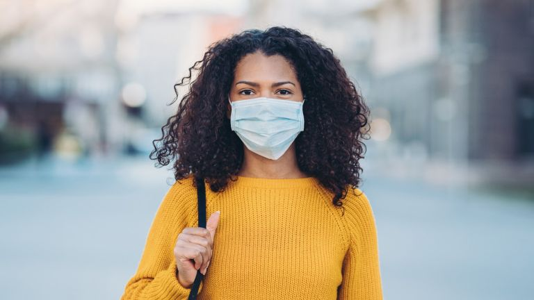woman wearing face mask in the street