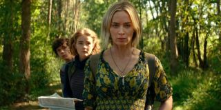 Marcus, Regan and Evelyn Abbot walk through the woods in A Quiet Place Part II