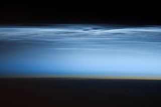 An photograph of night-shining clouds taken with a Nikon D3S digital camera using a 400 millimeter lens by an astronaut aboard the ISS on January 5, 2013.