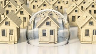 The complete guide to homeowners insurance: image shows miniature houses