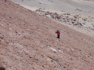 A researcher climbs up Mount Llullaillaco in Argentina.