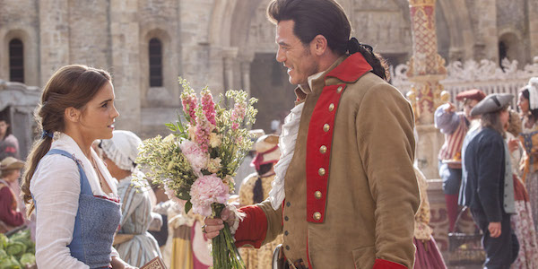 Gaston giving Belle flowers in Beauty and the Beast