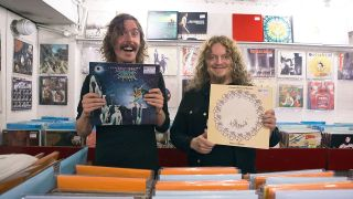 A photograph of Mikael Åkerfeldt and Opeth holding up records