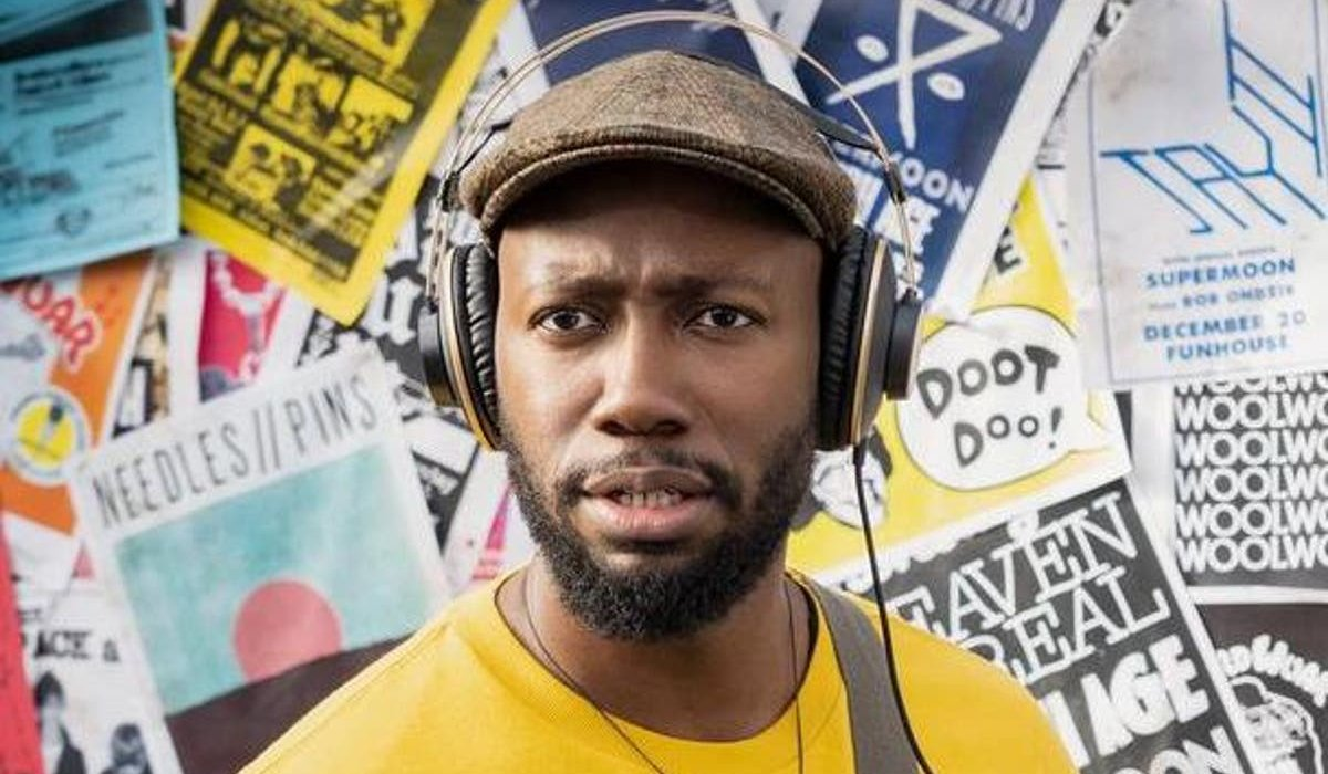 Woke Lamorne Morris with his headphones on, in front of a board
