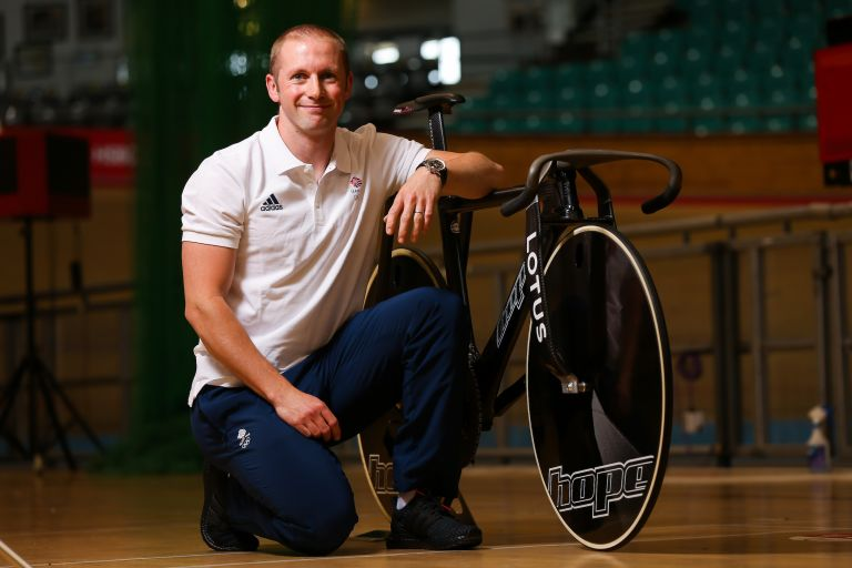 Jason Kenny posing with his Hope Lotus bike before the Tokyo 2020 Olympic Games