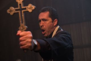 A priest tries to repel evil