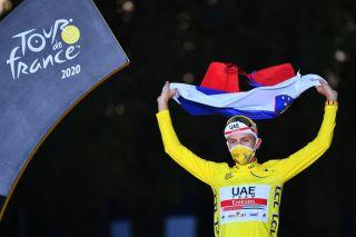 Tadej Pogacar wears the yellow jersey as the winner of the Tour de France