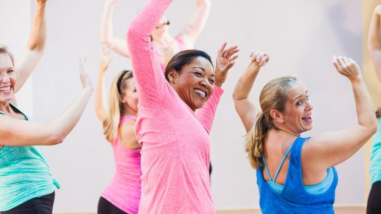 A group of older women enjoying a Zumba dance exercise class