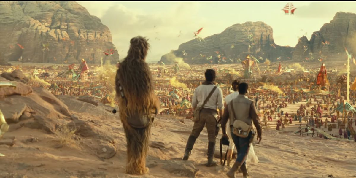Star Wars cast approaching a city in the desert