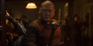 Wong (Benedict Wong) stares at a staff in Doctor Strange (2016)