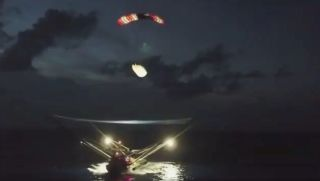 Half of a SpaceX Falcon 9 payload fairing settles into the net of the boat GO Ms. Tree on the night of Aug. 6, 2019, in this screenshot from a video posted on Twitter by SpaceX founder and CEO Elon Musk.