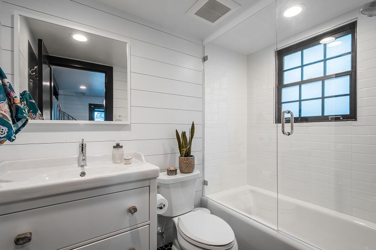 a modern white bathroom with vanity