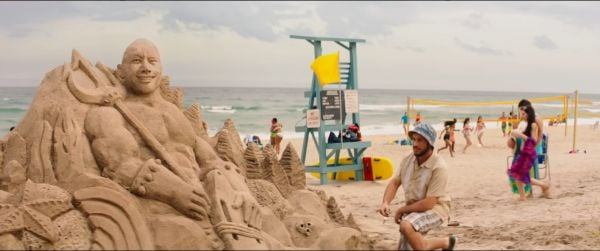Sand sculpture of Dwayne Johnson in Baywatch