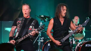 James Hetfield and Kirk Hammett perform live with Metallica.