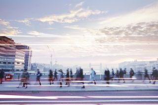 People walking through a city.