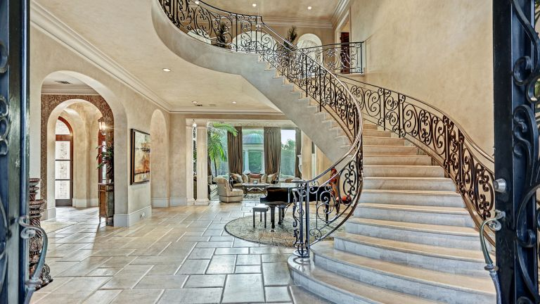 Tracy McGrady's hallway with sweeping staircase