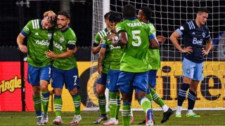 Jordan Morris of the Seattle Sounders FC celebrates with Cristian Roldan after scoring a goal against Vancouver Whitecaps FC at the MLS is Back Tournament on July 19, 2020 in Reunion, Florida.