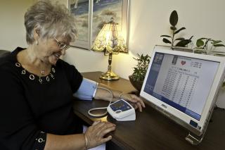 woman checks her blood pressure